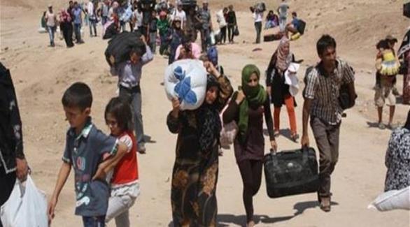 آلاف العراقيين الفارين من الموصل يصلون إلى سوريا