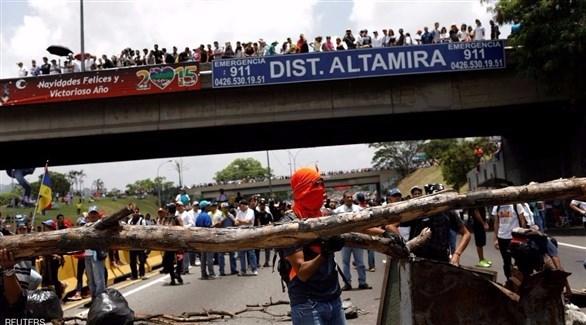 فنزويلا: المحتجون يواصلون الاعتصام للضغط على الرئيس 2017425141504446K.jp