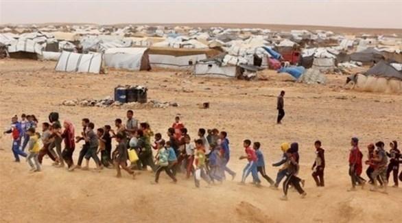 أطفال سوريون في مخيم الركبان على الحدود مع الأردن (أرشيف)