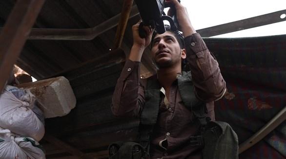 عنصر مقاتل في إدلب (أ ف ب)