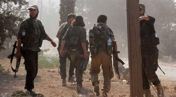 مسلحون من هيئة تحرير الشام في إدلب (أرشيف)