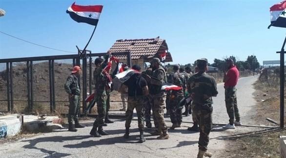 عناصر من قوات النظام السوري في معبر القنيطرة في الجولان المحتل (أرشيف)