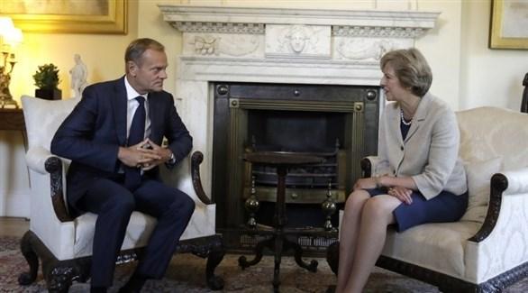رئيس المجلس الأوروبي توسك ورئيسة الوزراء البريطانية ماي (أرشيف)