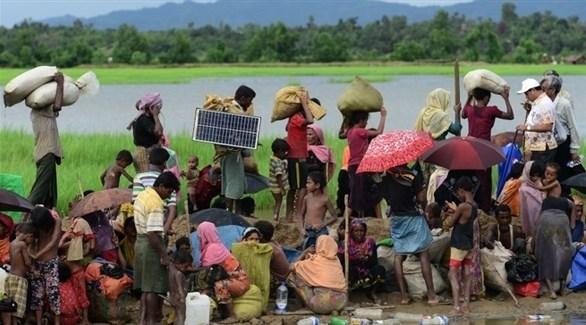 مسلمون من الروهينجا فارون من ميانمار (أ ف ب)