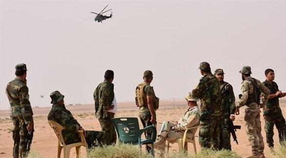 جنود من الجيش السوري النظامي بالقرب من البوكمال (أرشيف)