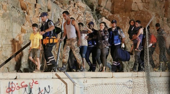 جانب من عمليات الإنقاذ في منطقة البحر الميت (إ ب أ)