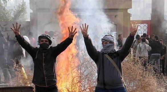 مشاغبون يرفعون شعار رابعة الإرهابي (أرشيف)