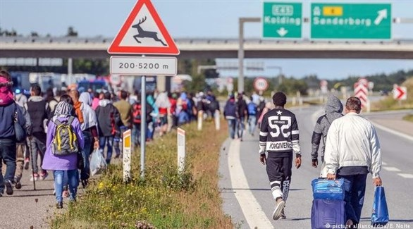 لاجئون بعد وصولهم إلى الدنمارك عبر ألمانيا في 2015 (أرشيف)