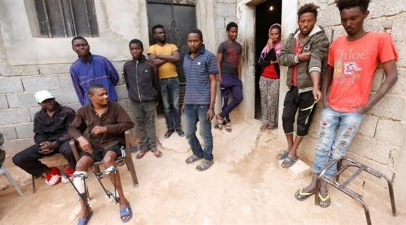 مهاجرين في مراكز احتجاز في ليبيا (رويترز)