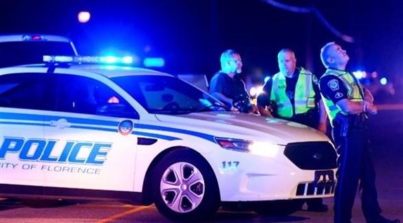 عناصر من شرطة فلورنس بعد إطلاق النار في  في فنتيدج بليس (سي إن إن)