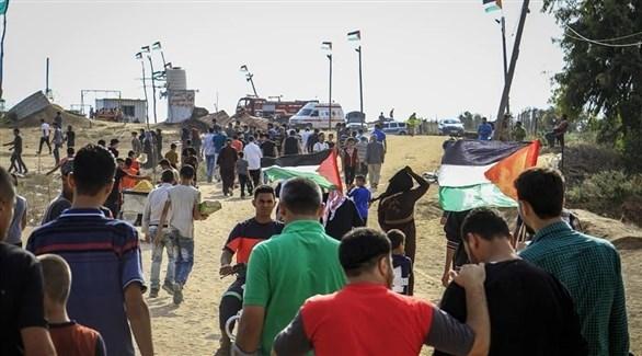 تجمع للفلسطينيين بالقرب من السياج الفاصل لغزة مع إسرائيل