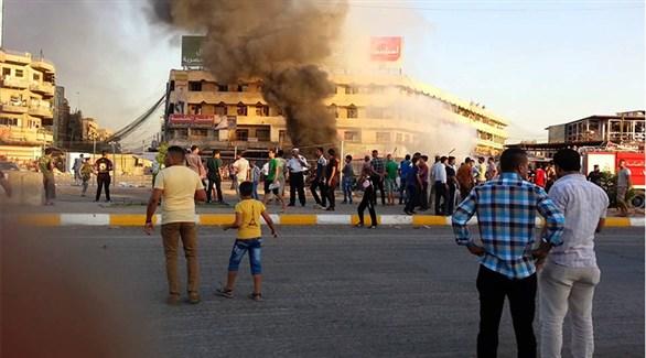 عراقيون في بغداد بعد انفجار سابق (أرشيف)