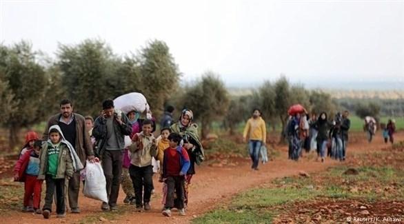 عودة مهجّرين سوريين إلى القصير (رويترز)