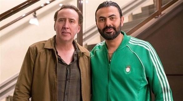 محمد كريم ونيكولاس كيدج (فيس بوك)