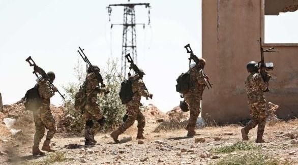 جنود من القوات النظامية السورية على مشارف إدلب (أرشيف)