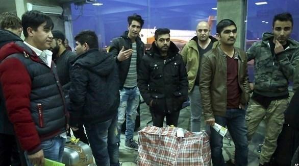 مهاجرون أفغان بعد عودتهم إلى كابول (أرشيف)