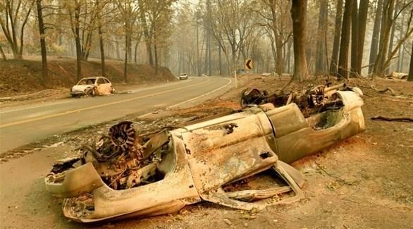 سيارات متفحمة في غابات كاليفورنيا بسبب الحريق (أ ف ب)