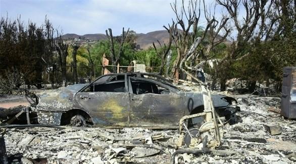 سيارة متفحمة في ضاحية ماليبو الشهيرة في كاليفورنيا (أ ف ب)