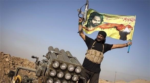 مسلح شيعي على متن آلية عسكرية في العراق (أرشيف)