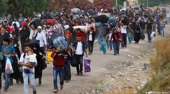 لاجئون في أوروبا (رويترز)