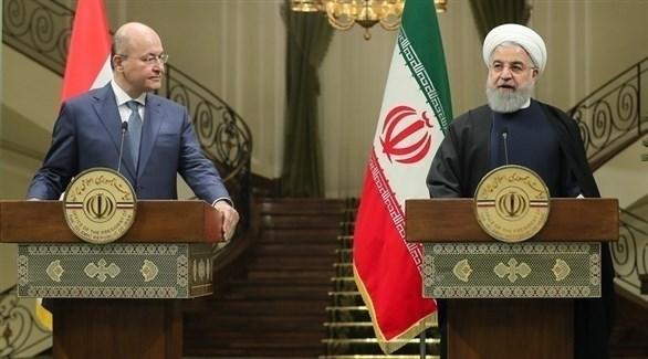 الرئيس الإيراني حسن روحاني ونظيره العراقي برهم صالح (إ ب أ)