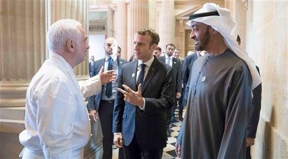 محمد بن زايد مع رئيس فرنسا إيمانويل ماكرون في باريس (وام)