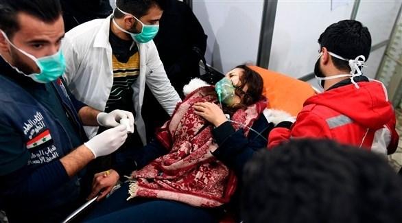 مصابون يتلقون العلاج داخل أحد المستشفيات السورية (أ ف ب)