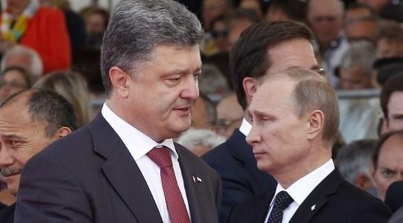 الرئيسان الأوكراني بيترو بوروشينكو والروسي فلادمير بوتين (أرشيف)