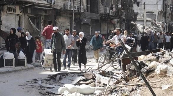 مدنيون في مخيم اليرموك (أرشيف)
