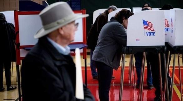 أمريكيون يدلون بأصواتهم في التصويت المبكر بولاية ماريلاند (أ ب)