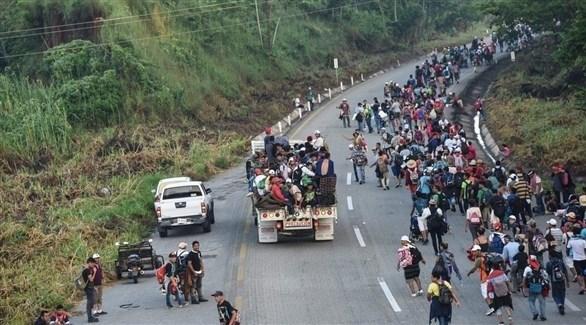 مهاجرون هندوراسيون يشاركون في القافلة المتجهة إلى الولايات المتحدة (أ ف ب)