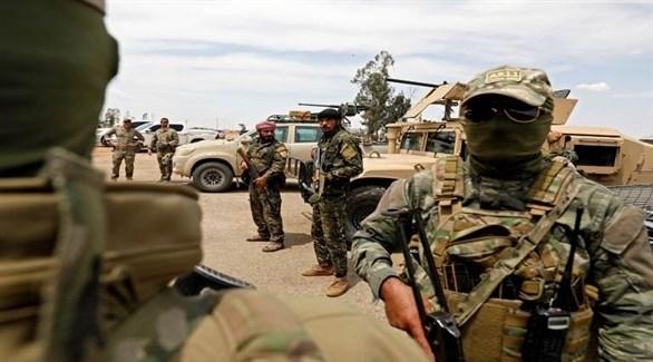 مسلحون من قوات سوريا الديمقراطية في الرقة السورية (أرشيف)