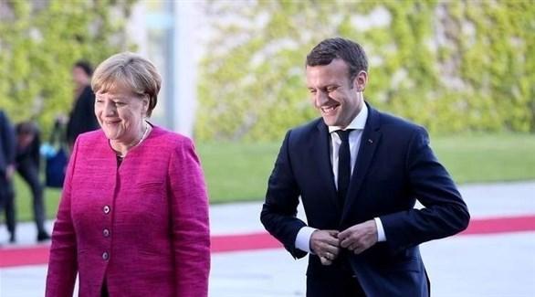المستشارة الألمانية أنجيلا ميركل والرئيس الفرنسي إيمانويل ماكرون (أرشيف)