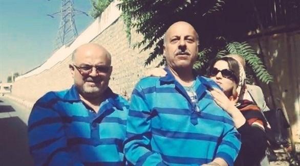 المحاميان قاسم شلعة سعدي وآرش كيخسروي يقتادان من السجن للمحاكمة (تويتر)