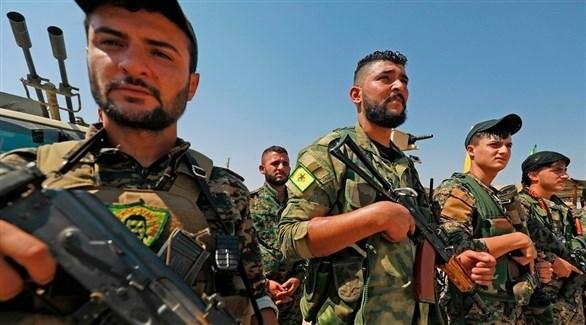 عناصر من وحدات حماية الشعب الكردي