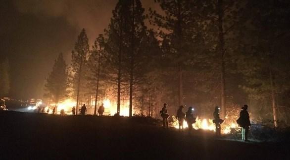 رجال إطفاء يحاولون السيطرة على حرائق كاليفورنيا في نوفمبر الماضي (أ ب إ)