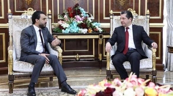 مستشار مجلس أمن إقليم كردستان مسرور بارزاني ورئيس البرلمان العراقي محمد الحلبوسي (أرشيف)