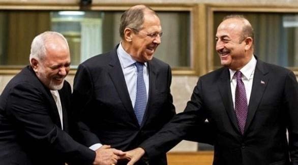 وزراء خارجية تركيا وروسيا وايران في جنيف أمس (إ ب أ)