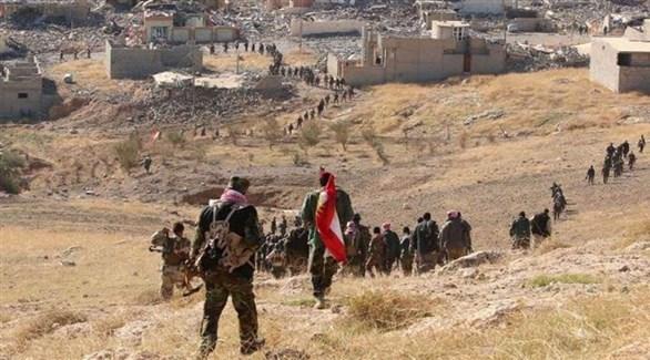مقاتلون أكراد يقطعون سنجار (أرشيف)