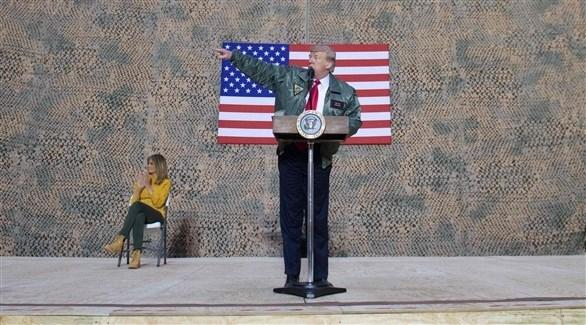الرئيس الأمريكي متحدثاً من قاعدة عين الأسد في الأنبار العراقية (أ ف ب)
