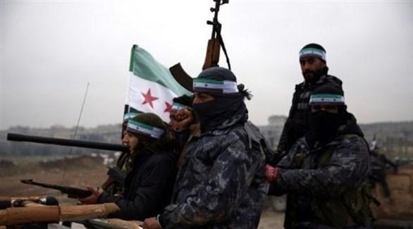 مقاتلون سوريون تدعمهم تركيا ميغادرون جرابلس الحدودية استعداداً للتحرك باتجاه منبج  (أ ف ب)