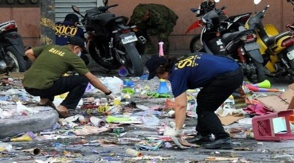 الشرطة العلمية الفلبينية تجمع أدلة وعينات بعد تفجير اليوم في كوتاباتو (أ ف ب)