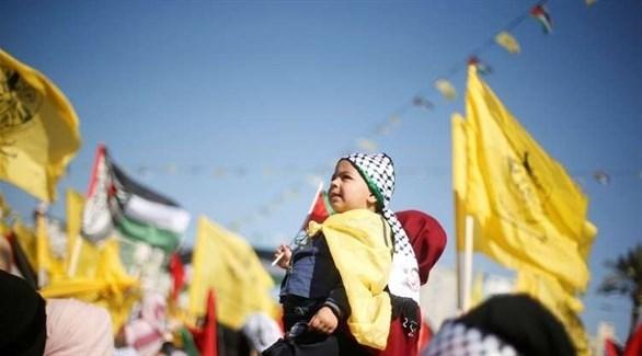 فلسطينيون يحتفلون بذكرى انطلاق حركة فتح (أرشيف)