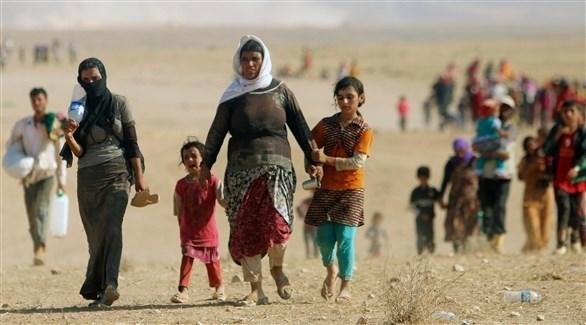نازحون إيزيديون هاربون من غزو داعش (أرشيف)