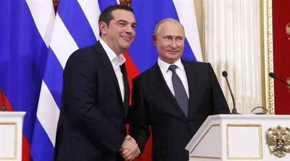 بوتين إلى جانب رئيس الوزراء اليوناني أليكسيس تسيبراس في موسكو (وسائل إعلام روسية)