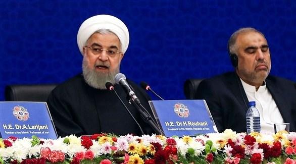 روحاني متحدثاً في المؤتمر (أ ف ب)