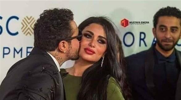 أحمد الفيشاوي برفقة زوجته على السجادة الحمراء في مهرجان الجونة