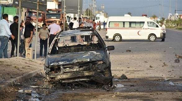 سيارة متفحمة إثر انفجارها بعبوة ناسفة في كركوك (أرشيف)