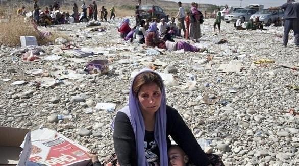 امرأة عراقية إيزيدية هاربة من بطش تنظيم داعش الإرهابي (أرشيف)