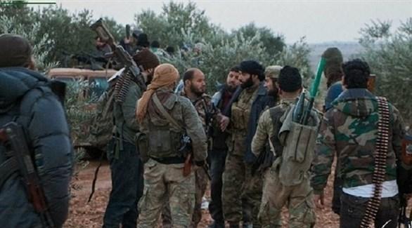 مسلحون من هئية تحرير الشام في حلب السورية (أرشيف)